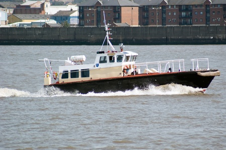 venom: Workboat Venom in the River Mersey, Liverpool in the background.