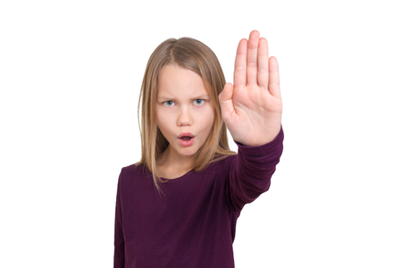 A schoolchild signals stop with the raised hand. It calls the word stop, depth of field, portrait, half figure