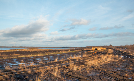 Landscape shot with tracks and points system of a peat train