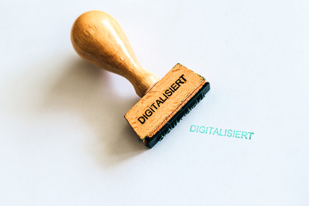 A wooden stamp marks the geman word digitalisiert which means digitized