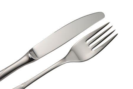 cuchillo y tenedor: Cuchillo y tenedor aislados en blanco.  Foto de archivo