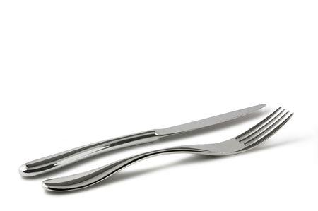 the knife: Tenedor y cuchillo aislados en blanco. Incluido el trazado de recorte.