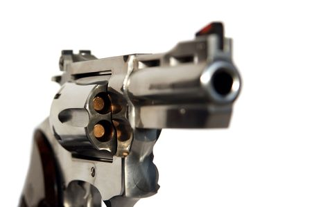 Loaded steel revolver caliber 38 isolated on white background photo