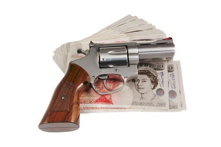 38 caliber: Revolver lying on fifty pounds banknotes.