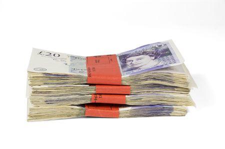 sterlina: Quattro mila sterline isolati su bianco.  Archivio Fotografico