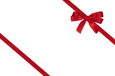 Red bow and two slanting ribbons isolated on white. photo