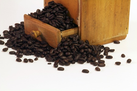 Coffee beans in an antique coffee grinder