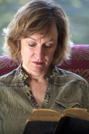 Close up photo of baby boomer woman reading a book with backlighting Stock Photo - 8784108