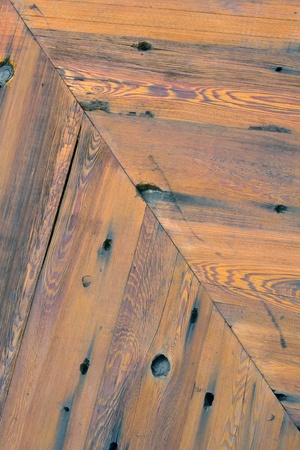 Diagonal picture of detail on a wooden door.