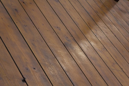 diagonal: Beautiful wooden decking in natural subdued light. Diagonal background patterm Stock Photo