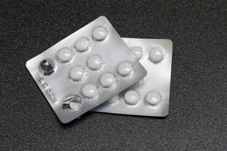packs of pills: Two packs of pills