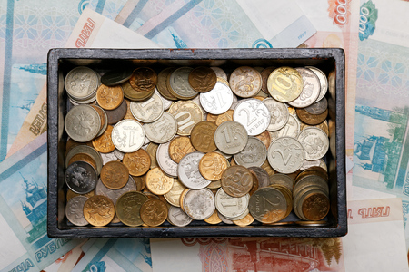 bonds: Box with coins on bonds background