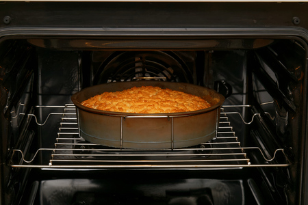 baking oven: Cake is baked in the oven