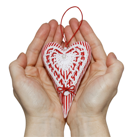 Handmade heart in palms on Valentines day photo