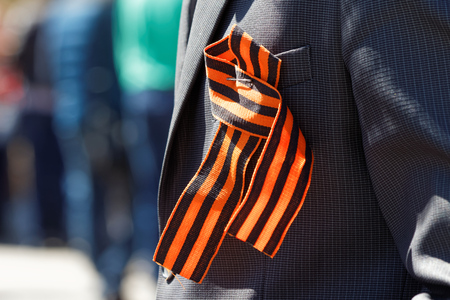 feast day: Saint George ribbon on his lapel. The feast day of victory on May 9th Stock Photo