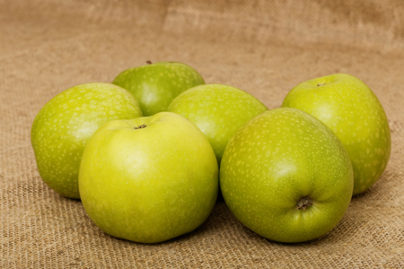 bagging: Six small green apple on the bagging Stock Photo
