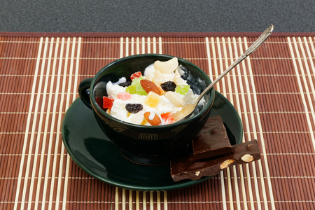 icecream with raisins, chocolate and dry fruits in coffee cup photo