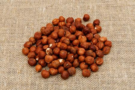cobnut: Heap of dry hazel nuts on sackcloth