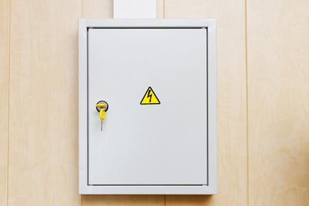hinged: Grey Hinged Power Supply Box on the Wall Stock Photo