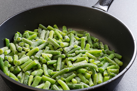 Closeup cuted green french bean on the pan ready for frying Stock Photo