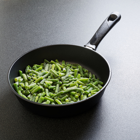 french bean: Cuted green french bean on the pan ready for frying