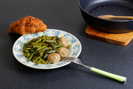 haricot vert: Stewed noisettes with green french bean and croissant Stock Photo