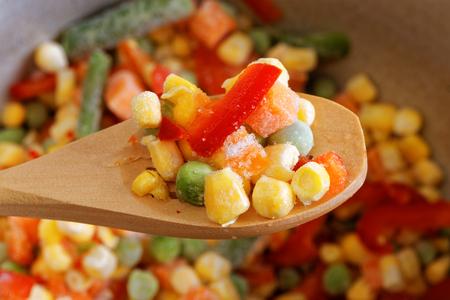 haricot vert: Closeup wooden spoon with frozen mixed vegetables