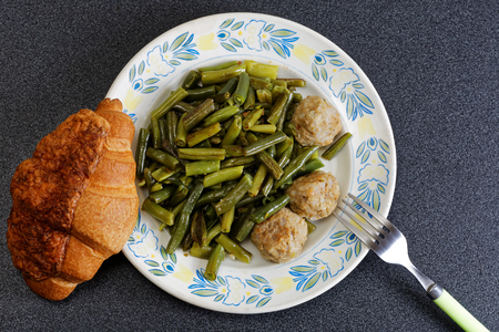 french bean: Stewed noisettes with green french bean and croissant Stock Photo