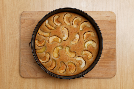 wooden table top view: Homemade apple pie on the wooden table. Top view. Stock Photo