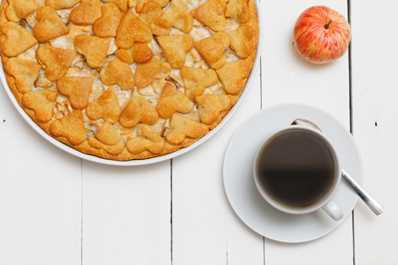 cup cakes: Cup of coffee and homemade pie with apples and pears on white wooden table Stock Photo