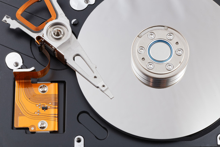 gigabyte: Inside opened hard disk drive (HDD). Isolated on white.