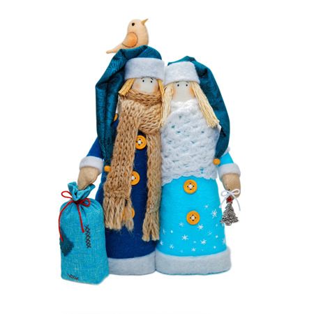 'ded moroz': Two Handmade Christmas toys. Russian Ded Moroz and Snow-maiden in blue costume and hats. Isolated on white.
