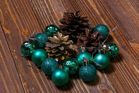 pinecone: Christmas balls and pinecone on wooden background Stock Photo