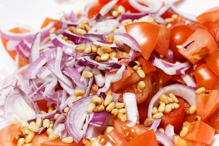 pinoli: Closeup ingredients for a salad - sliced vegetables and pine nuts
