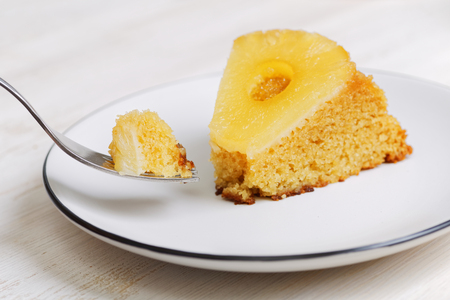 upside down: Piece of pineapple Upside Down Cake and fork