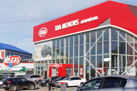 selling service: Ulyanovsk, Russia - May 22, 2016: Building of KIA MOTORS car selling and service center with KIA sign. Editorial