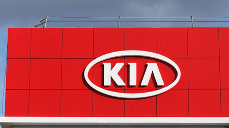 selling service: Ulyanovsk, Russia - May 22, 2016: KIA sign on building KIA selling and service center.