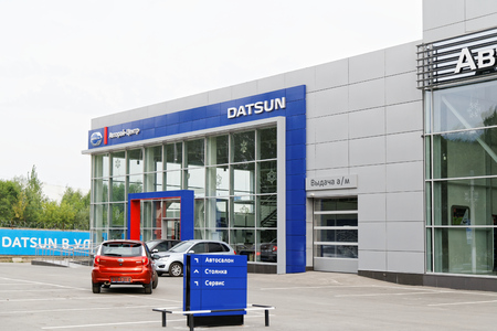 selling service: Ulyanovsk, Russia - July 20, 2016: Building of Datsun car selling and service center with Datsun sign. Editorial