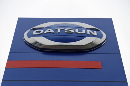 selling service: Ulyanovsk, Russia - July 20, 2016: Promotional stand with Datsun sign near building Datsun service center, which provides vehicle maintenance, repairs and diagnostics. Editorial