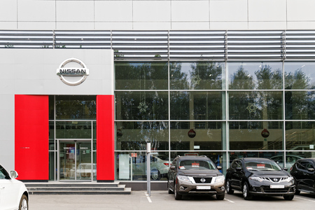 selling service: Ulyanovsk, Russia - July 20, 2016: Building of Nissan car selling and service center with Nissan sign.