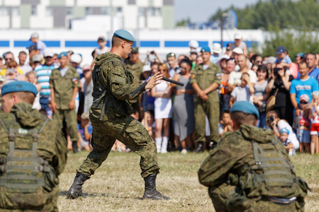 possession: Ulyanovsk, Russia - July 31, 2016: Demonstrations of soldiers during the celebration of the Airborne Forces. Soldier demonstrates possession of nunchaku. Editorial