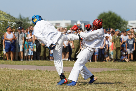 troop: Ulyanovsk, Russia - July 31, 2016: Airborne soldiers demonstrate mastery of martial arts during the celebration of the Airborne Forces.