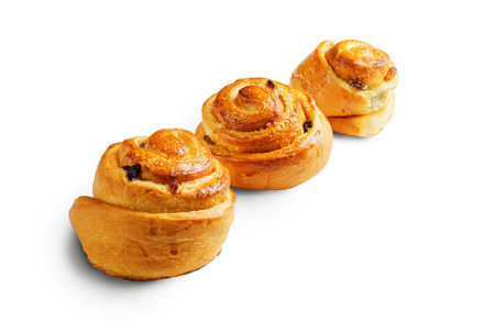 angle view: Three buns with raisin isolated on white. Angle view. Clipping path. Shadow. Stock Photo