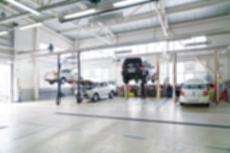 service: Blurred defocused background of car service and repair centre.