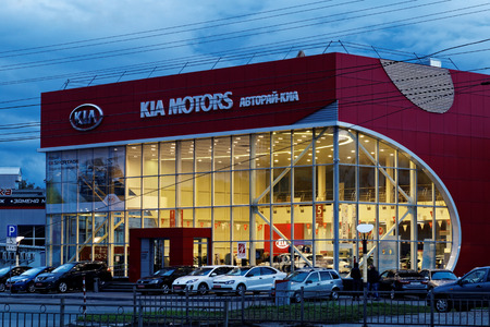 selling service: Ulyanovsk, Russia - September 17, 2016: Building of KIA MOTORS car selling and service center with KIA sign on a background of the evening sky. Editorial