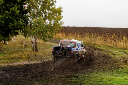 raid: Ulyanovsk, Russia - September 24, 2016. Rally raid Hills of Russia. SUV Rally on a dirt road between the forest and field. Editorial