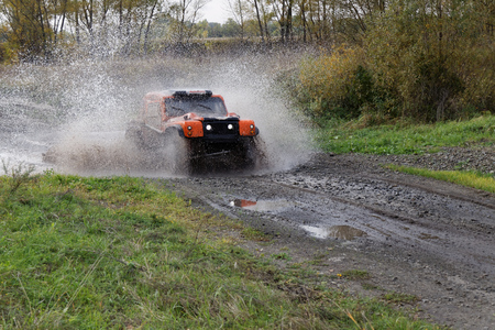 raid: Ulyanovsk, Russia - September 24, 2016. Rally raid Hills of Russia. Rally car boosts water hurdle surrounded by splashes.