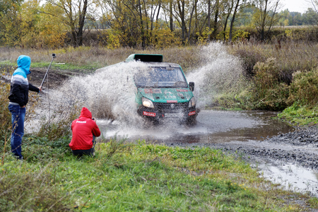 raid: Ulyanovsk, Russia - September 24, 2016. Rally raid Hills of Russia. 4wd vehicle boosts water hurdle surrounded by splashes.