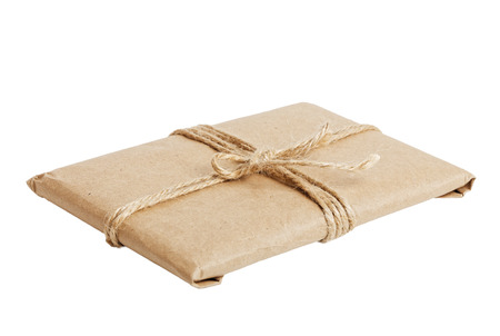 angle view: Gift parcel with kraft paper tied with twine isolated on white background. Angle view. Stock Photo