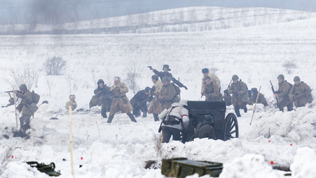 soldiers: Ulyanovsk, Russia - February 25, 2017:  Scene of battle during reenactment of World War II battle. Military-historical festival Immortal feat Editorial